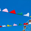 Royalty-Free Stock Photo: Colored flags and a Ferris wheel