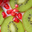 Pomegranate and kiwi — Stock Photo