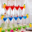 Pyramid of glasses with green, red and blue cocktails — Stock Photo