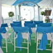 White folding chairs setup for a wedding ceremony — Stock Photo #23278126