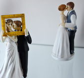 Figures of brides and bridegrooms for a wedding cake on top — Stock Photo