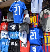 Souvenir shop with T-shirts in Italy — Stock Photo