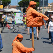 Two fakirs in orange outfit in streets — Stock Photo #34249517