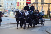 Horse-driven carriage and coachman in Vienna — Stock Photo