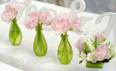 Pink flowers in green glass vases — Foto Stock