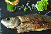 Fish, Sea Bass Grilled With Lemon And Grilled Vegetables — Stock Photo