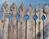 Wooden fence against dark blue sky background  with copy space — Stock Photo