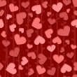 Seamless background pattern with red and pink hearts — Φωτογραφία Αρχείου