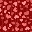 Seamless background pattern with red and pink hearts — 图库照片