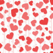 Seamless background pattern with red and pink hearts — Stockfoto