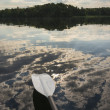 Kayak Paddle Above Cloud Reflection — Stock Photo #21692059