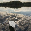 Stock Photo: Kayak Paddle Above Cloud Reflection