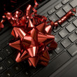 Red Ribbon on Laptop — Stock Photo