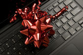 Red Ribbon on Laptop — Stockfoto