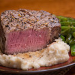 Filet Mignon with Bite taken out, Medium Rare - Stock Photo