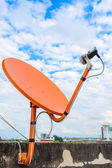 Satellite dish is orange — Zdjęcie stockowe