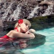 The girl lies in water — Stock Photo
