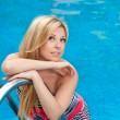 Stock Photo: Portrait of a beautiful girl in the pool