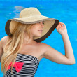 Stock Photo: Beautiful girl in hat at pool
