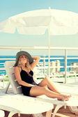 The girl sunbathes on the yacht — Stock Photo