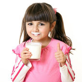 Girl with a glass of milk — Stock Photo