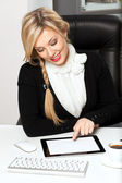 Businesswoman in the office with tablet — Stock Photo