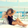 The girl sunbathes on the yacht — ストック写真