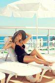 The girl sunbathes on the yacht — Stock Photo