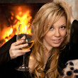 Beautiful girl by the fireplace — Stock Photo #22260455