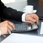 Businessman said on the calculator — Stock Photo #22260499
