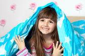 Girl under the blanket — Stock Photo