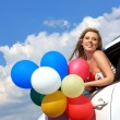 Royalty-Free Stock Photo: Portrait of a girl in the car with colorful balloons