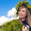 Portrait of the beautiful girl in a wreath which reaps a crop in — Stock Photo #22364649