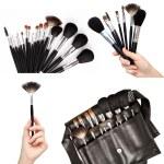Women hands holding make-up brushes — Stock Photo #26682343