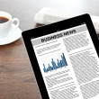Stock Photo: Tablet with business news in screen on table at businessma