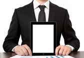 Empresario en oficina sostiene tablet con pantalla aislada — Foto de Stock