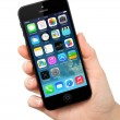 New operating system IOS 7 screen on iPhone 5 Apple — Stock Photo