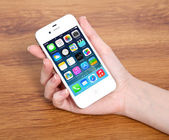 New operating system IOS 7 screen on iPhone 4S Apple — Stock Photo