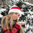 Girl near Christmas tree with snow — Stock Photo