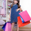 The girl in a dress and shoes standing with shopping bags in nur — Stock Photo