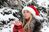 Beautiful girl near Christmas tree with snow — Stock Photo