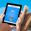 Girl lying on a deck chair by the pool and holding a tablet with — Stock Photo #32271961