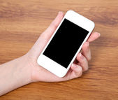 Woman hand holding a touch white phone with with black screen — Stock Photo