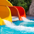 Red and yellow slides in a water park — Stock Photo