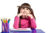 Isolated little girl is sitting at the table with colored pencil — Stock Photo