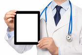 The doctor in a white coat with a stethoscope holding tablet wit — Stock Photo