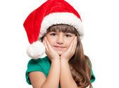 Isolated portrait of a little girl in a Christmas hat — Stock Photo
