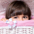 Stock Photo: Portrait of little girl with big eyes in pink room