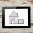 Tablet with drawing of apartment house on the screen on a backgr — Stock Photo