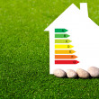 House with the sign of energy saving on a background of grass — Stock Photo